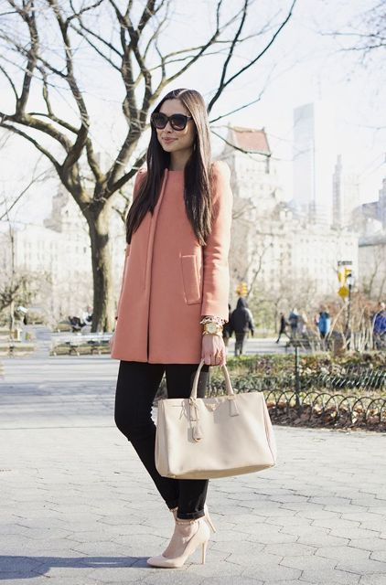 With black pants, beige pumps and beige bag