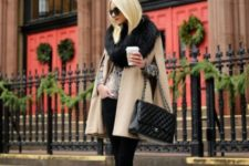 With black pants, heels and chain strap bag