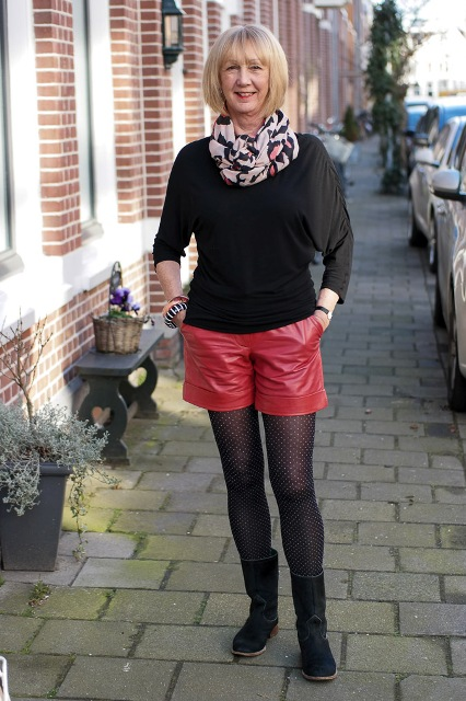 With black shirt, printed scarf, red shorts and mid calf boots