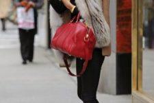 With black turtleneck, fur collar, black pants and red bag