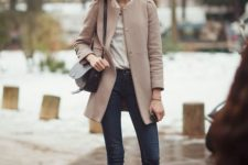 With blouse, skinny jeans, flat boots and bag
