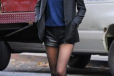 With blue shirt, black blazer and shoes