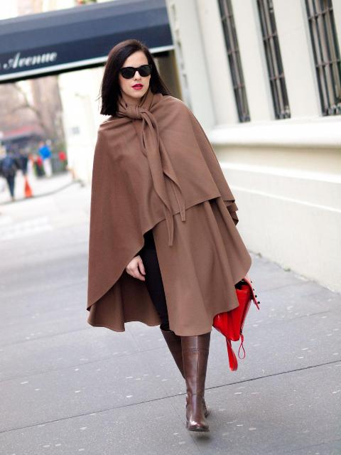 With brown high boots, red bag and black pants