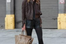With brown leather jacket, beanie, ankle boots and beige tote