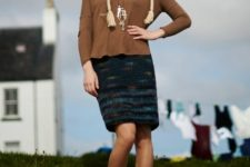 With brown shirt, printed skirt and fur boots