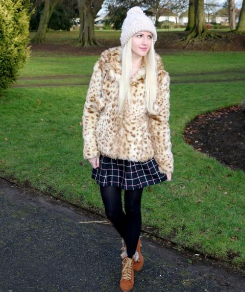 With checked skirt, black tights, brown boots and beanie