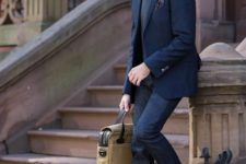 With cuffed jeans, navy blue blazer, gray vest and bag