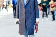 With cuffed jeans, tweed coat, black socks and black shoes