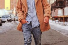 With denim shirt, distressed jeans, white sneakers and fur coat