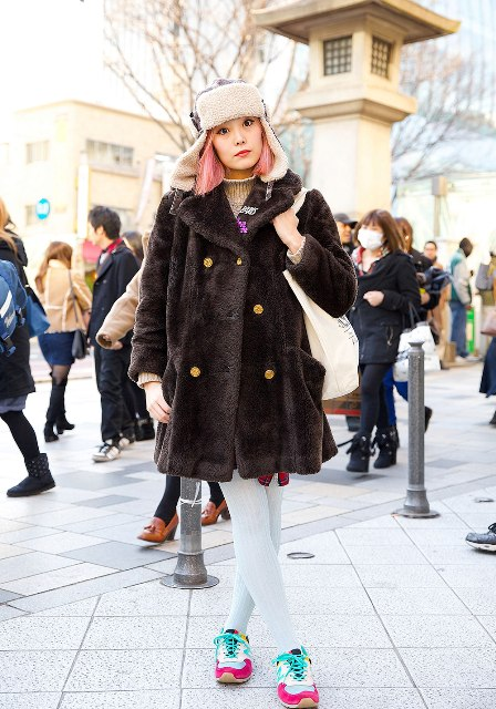 With fur coat, plaid dress, white tights and colorful sneakers