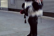 With fur jacket, leather pants, white sneakers and backpack