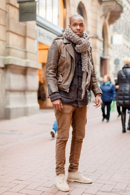 With gray cardigan, leather jacket, oversized scarf and brown pants