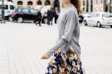 With gray loose sweater and floral maxi skirt