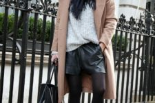 With gray oversized sweater, white sneakers, black scarf, black tote and camel coat