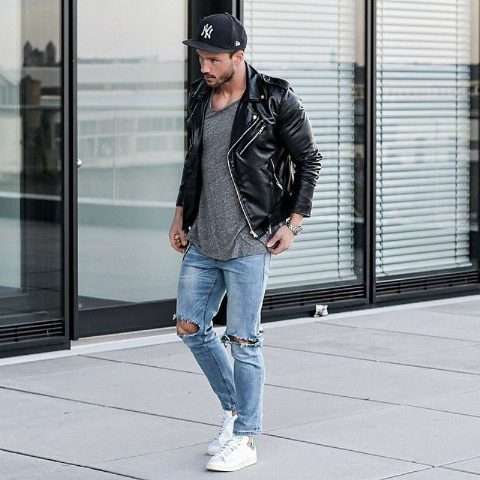 With gray shirt, black leather jacket, distressed jeans and white sneakers