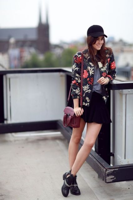With gray shirt, black mini skirt, ankle boots, marsala bag and floral jacket