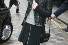 With gray shirt, black skirt and leather jacket