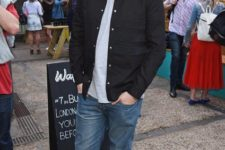 With gray shirt, jacket, jeans and black sneakers