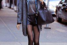 With gray shirt, mini coat, printed boots and black bag