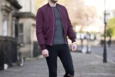 With gray shirt, purple jacket, distressed pants and gray shoes