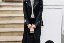 With gray sweater, black leather jacket, ruffle pants, red boots and black bag