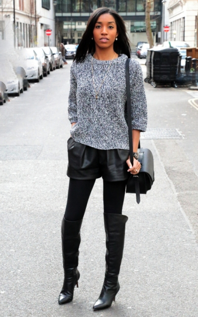 With gray sweater, over the knee boots and bag