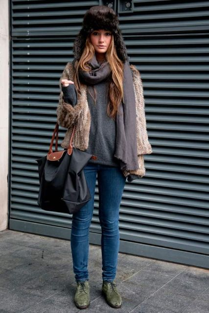 With gray sweater, skinny jeans, green suede shoes, fur jacket and tote