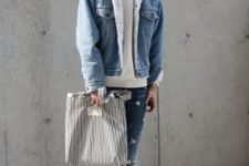 With gray sweatshirt, distressed jeans, gray beanie, striped socks, brown shoes and striped tote