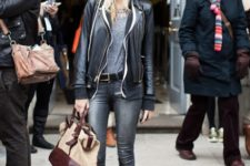 With gray top, black jacket, gray jeans and two color bag