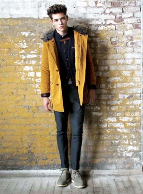 With gray trousers and yellow parka coat