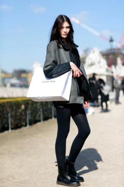 With leather jacket, leather boots and black tights