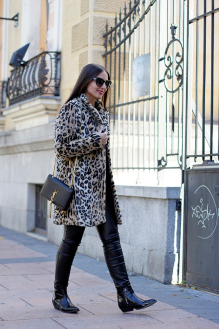 With leather pants, boots and chain strap bag