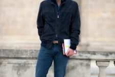 With navy blue cardigan and jeans