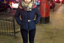 With navy blue jacket, jeans and plaid scarf