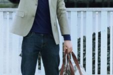 With navy blue turtleneck, beige jacket, jeans and two color bag