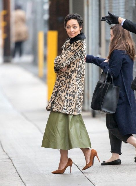 With olive green midi skirt and brown pumps