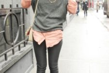 With pale pink shirt, gray sweater and dark gray pants