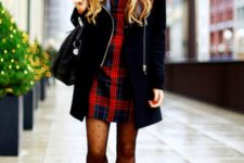 With plaid dress, black coat and printed tights