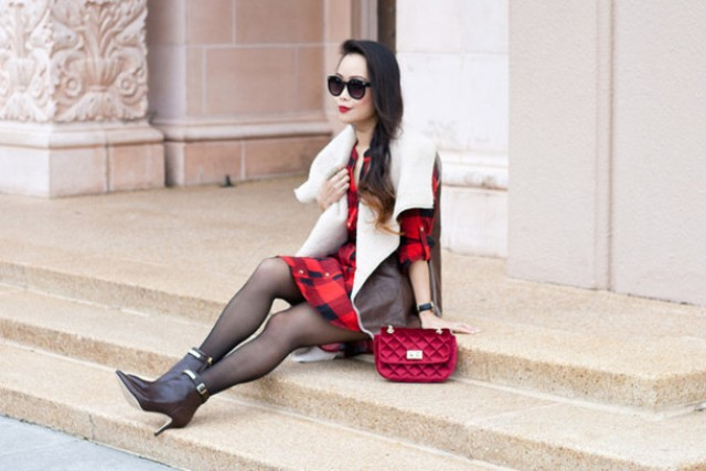 With plaid dress, black tights, heeled boots and red bag