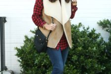 With plaid shirt, cuffed jeans, suede ankle boots and black bag