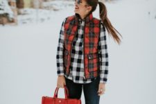 With plaid shirt, jeans, duck boots and red bag