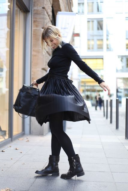 With pleated skirt and turtleneck