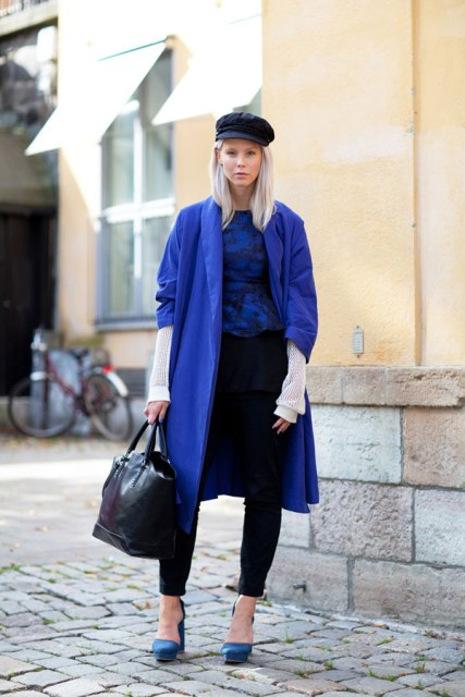 With printed shirt, black trousers, blue shoes, blue coat and black bag