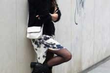 With printed skirt, black sweater and white bag