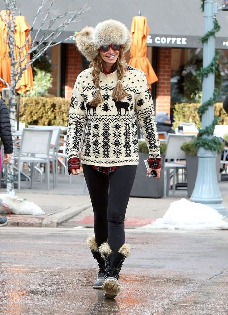With printed sweater, leggings and fur boots