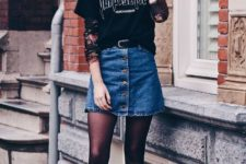 With printed t-shirt, denim skirt and black tights