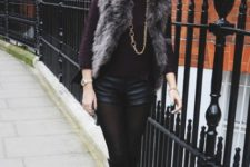 With purple shirt, faux fur vest and high boots