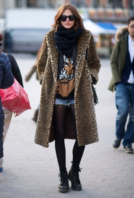 With scarf, printed shirt, denim shorts, black tights and flat boots