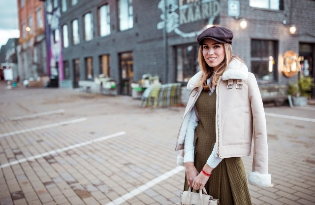 With shearling jacket, olive green dress and bag