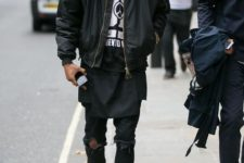 With shirt, distressed pants, white sneakers and black bomber jacket